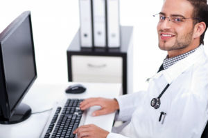 doctor-looking-through-paperless-medical-records